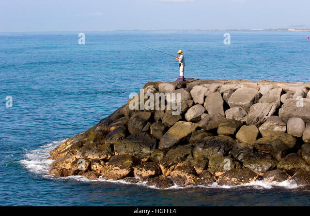 Surf casting stock photos surf casting stock images alamy for Fishing in hawaii oahu
