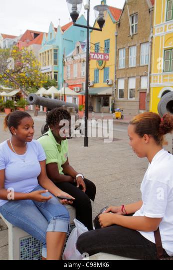 Curaçao Netherlands Antilles Dutch Willemstad Punda Handelskade waterfront UNESCO World Heritage Site student - Stock Image
