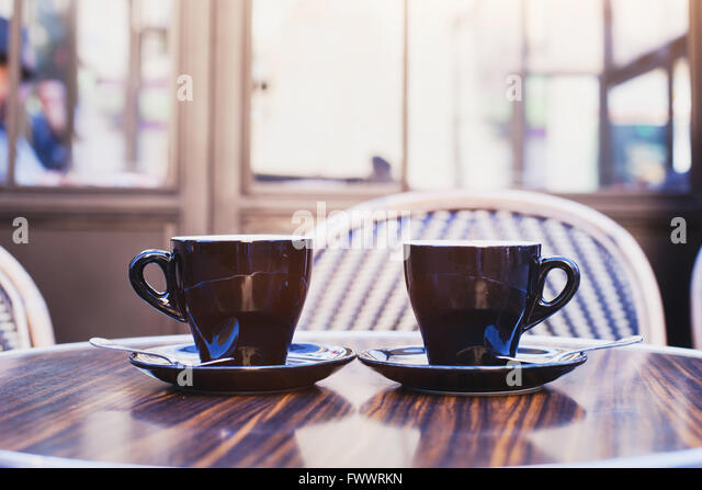 two cups of coffee on the table in cafe in Paris - Stock Image