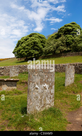 The Riley graves enclosed by a stone wall dedicated to John Hancock and his 6 children Eyam Derbyshire England GB - Stock Image
