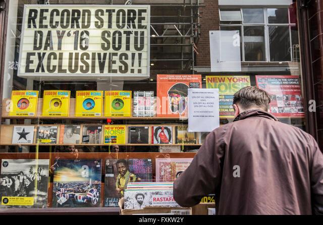 Consumers enjoying Independent Record Store Day in Soho, London, UK. - Stock Image