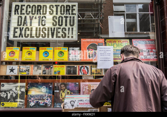 People shopping at Independent Record Store Day in Soho, London, UK. - Stock Image
