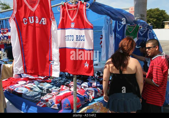 Miami Florida Little Havana Calle Ocho Carnaval jersey Cuba Puerto Rico hats souvenir couple shopping - Stock Image