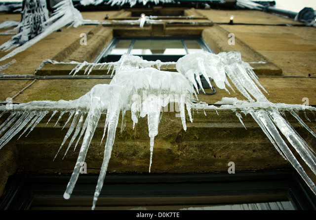 Icicles hanging from a pub window. - Stock Image