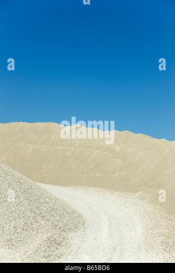 Gravel road in quarry - Stock-Bilder