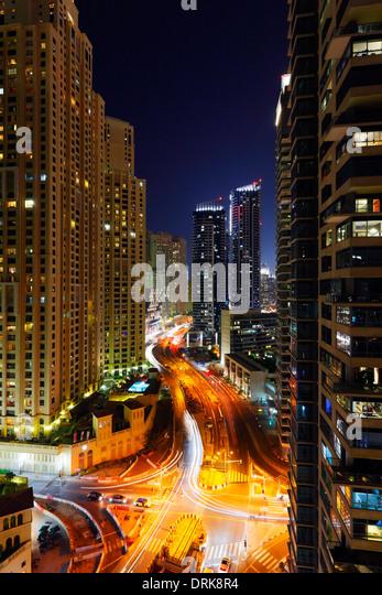 Buildings and street in Dubai Marina at night. King Salman Bin Abdulaziz Al Saud st. - Stock Image