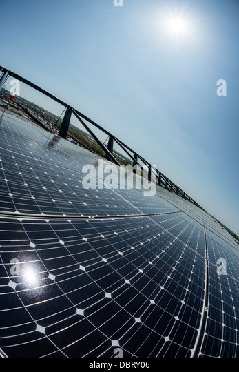 An array of solar photovoltaic panels used for converting sunlight into electrical energy in bright sunlight. - Stock Image