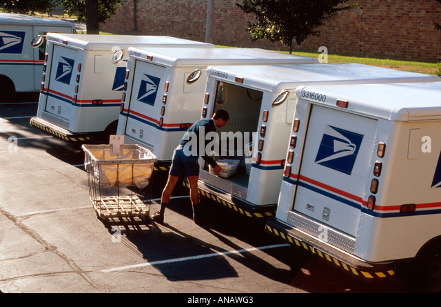 Ohio Oberlin US Post Office mail carrier delivery van mailman truck letters packages job parking lot - Stock Image