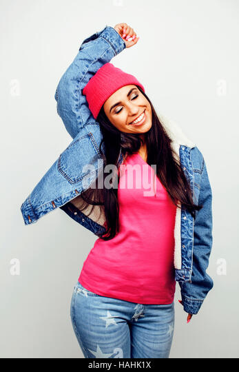 young happy smiling latin american teenage girl emotional posing on white background, lifestyle people concept - Stock Image