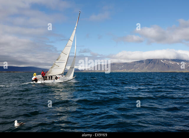 yacht sailing over faxafloi faxa bay from reykjavik iceland - Stock Image
