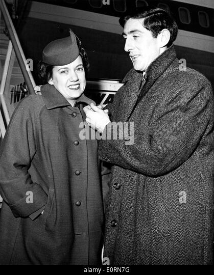 Runner Ron Delany with a TWA stewardess before boarding - Stock Image