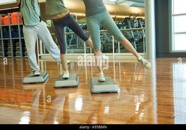 Step aerobics class, low section - Stock Image