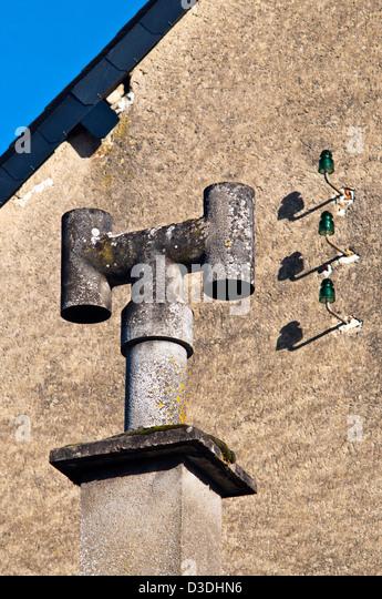 Asbestos H-chimney pot - France. - Stock Image