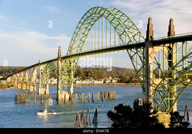 Yaquina Bay Bridge and fishing boat, Newport, Oregon USA - Stock Image