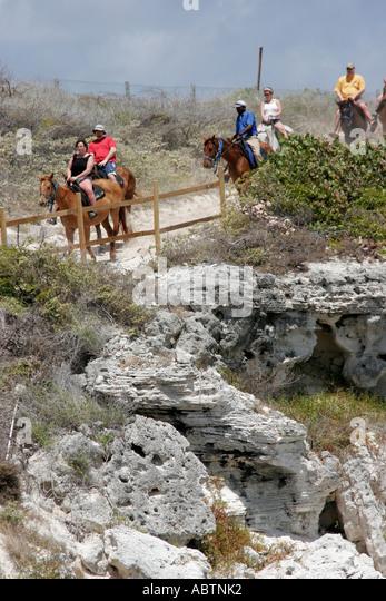 Grand Turk Atlantic Ocean Indigenous Horse Shelter horseback riding rocky cliff - Stock Image