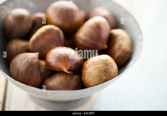 French Chestnuts in Metal Bowl - Stock-Bilder