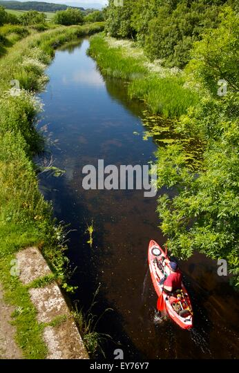 kayaking on 'Northern Reaches' of Lancaster Canal, Cumbria - Stock Image