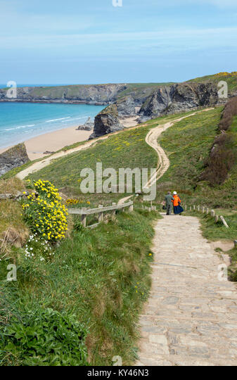 People walking on the South West Coast Path at Bedruthan Steps in Cornwall, England, UK - Stock Image