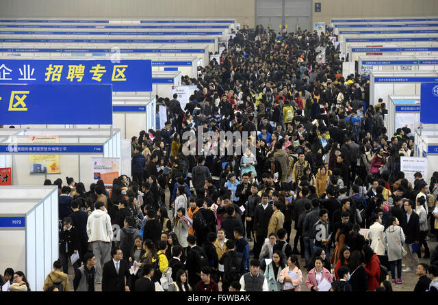 Nanjing, China's Jiangsu Province. 20th Nov, 2015. Students attend a job fair in Nanjing, capital of east China's - Stock Image