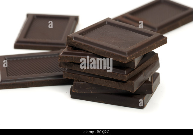Blocks of chocolate isolated on white - Stock Image