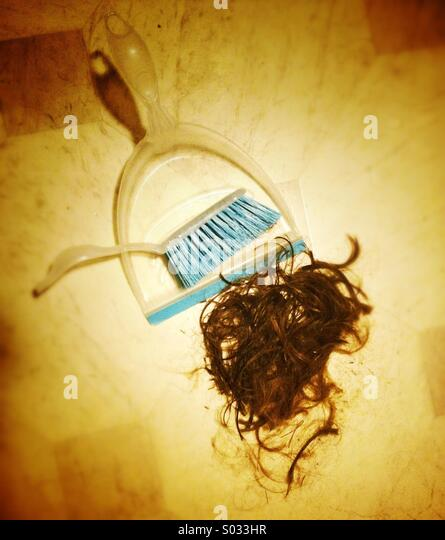 Hair cut, pan and brush with pile of cut hair - Stock Image