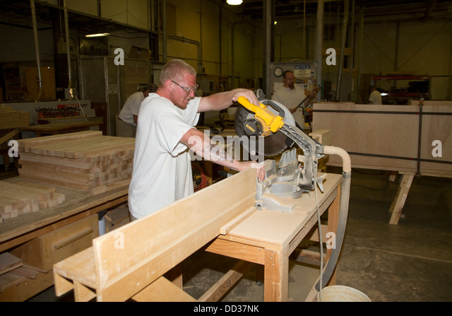Inmate working in the woodshop at the Lincoln, Correctional Center, USA. Here hey make furniture and vairous other - Stock Image