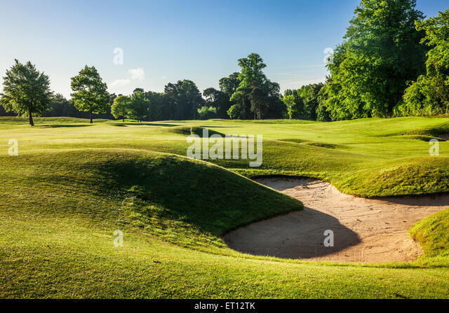 A  bunker on a typical golf course in early morning sunshine. - Stock Image