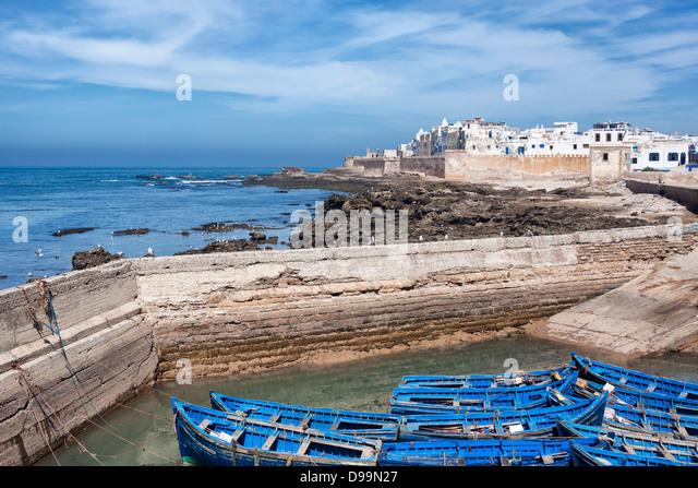 Coastal town Essaouira with blue boats and sea. - Stock Image