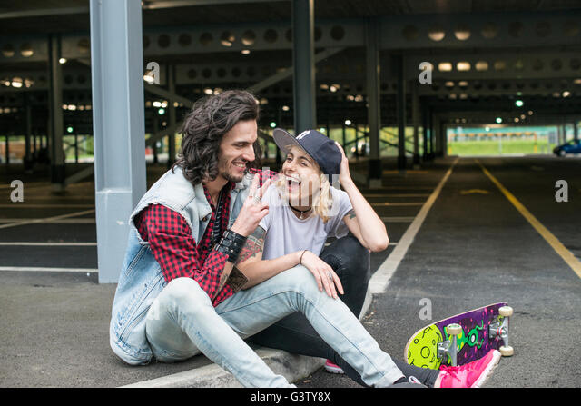 A cool young couple cuddling. - Stock-Bilder