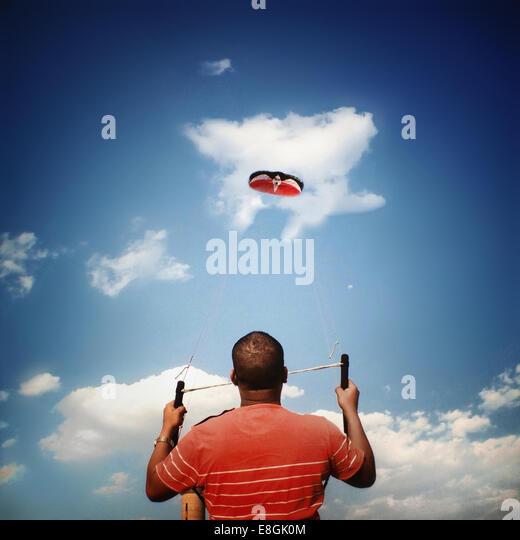 South Africa, Gauteng, Johannesburg, Roodepoort, Man holding kite - Stock Image