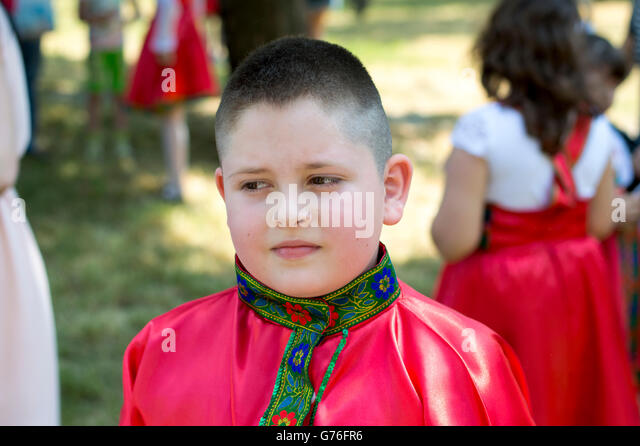 the boy in the Russian shirt during the holiday - Stock-Bilder