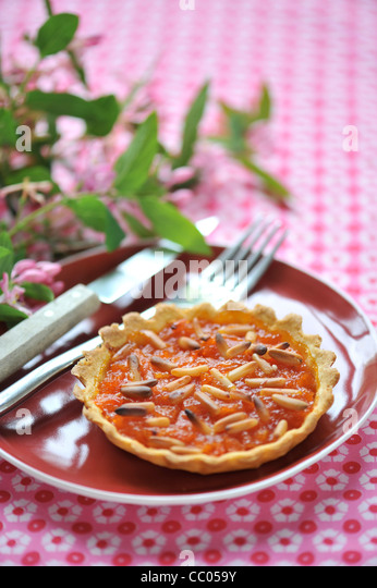 Tomato, Honey and Pinenuts Tartlets - Stock Image