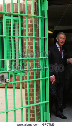 Britain's Prince Charles walks through a gated doorway during a visit to the Belmarsh prison in southeast London - Stock Image