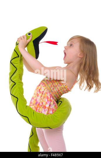girl fights with toy snake - Stock Image