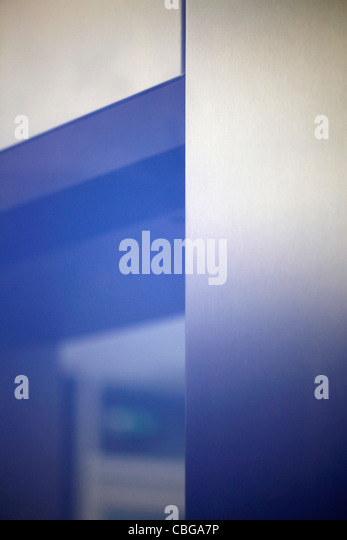 Blue light shining over elevator door - Stock-Bilder