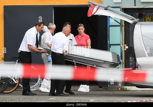 Konstanz, Germany. 30th July, 2017. Undertakers carry a coffin out of the side entrance of Club Grey in Konstanz, - Stock Image