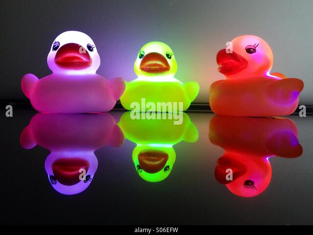 Colorful rubber ducks in water