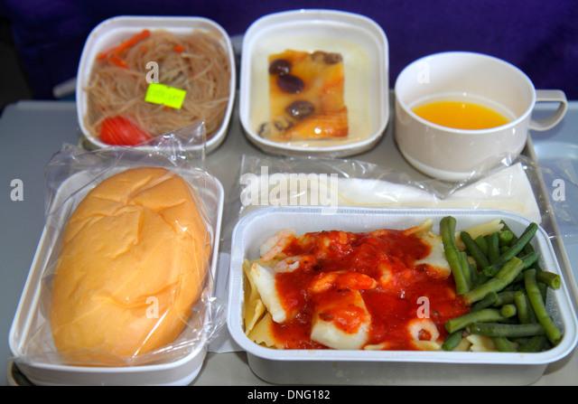 China Hong Kong Chek Lap Kok Hong Kong International Airport HKG onboard Air China airline food tray seafood green - Stock Image