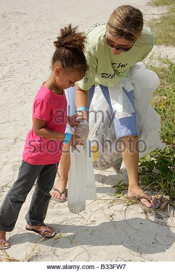 Miami Beach Florida ECOMB Environmental Coalition of Miami Beach Big Sweep beach cleanup volunteer trash litter - Stock Image