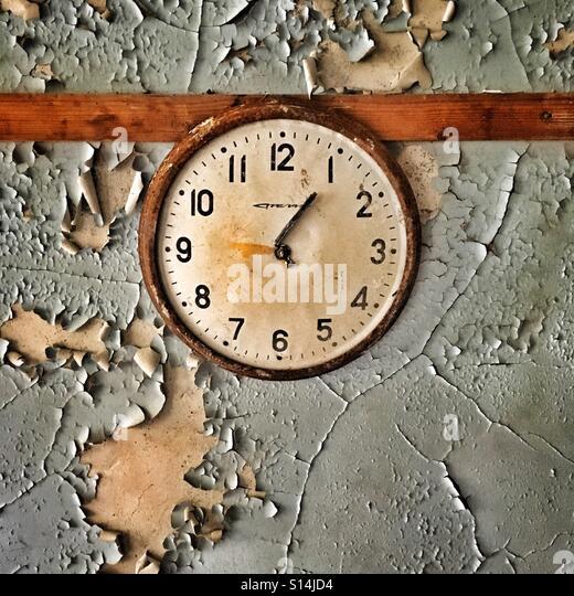 Clock in abandoned school in Pripyat ghost town, Chernobyl Nuclear Power Plant Zone of Alienation, Ukraine - Stock-Bilder
