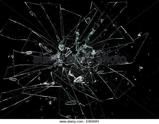 shattered & broken glass against black background - Stock Image