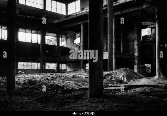 Abandoned factory. Asbestos disposal - Stock Image