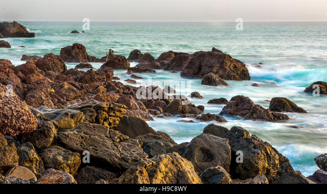 The beautiful waters of the Atlantic ocean with its rocky coastline near the City of Dakar in Senegal - Stock Image