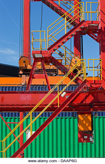 Cargo containers and platform with stairs at commercial dock - Stock Image