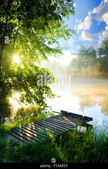 Fishing pier on river in the morning - Stock Image