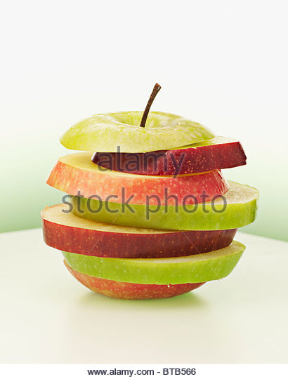 Alternating red and green apple slices - Stock Image
