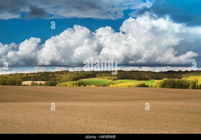 Summer sky with Cumulus and Cumulonimbus Calvus rain clouds - France. - Stock Image