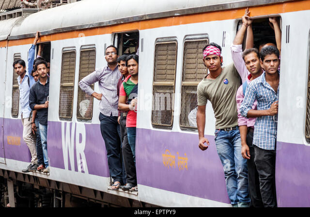 India Asian Mumbai Dharavi Mahim Junction Railway Station Western Line train public transportation riders passengers - Stock Image