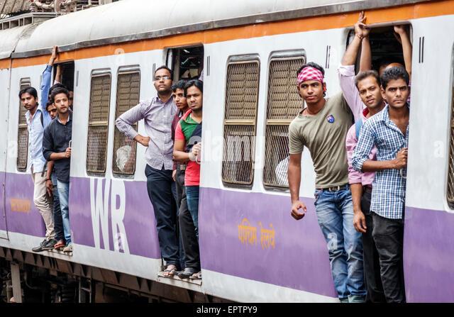 Mumbai India Asian Dharavi Mahim Junction Railway Station Western Line train public transportation riders passengers - Stock Image