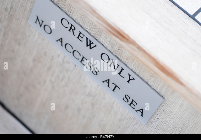 'Crew only no access at sea' sign on board a super yacht. Picture by Patrick Steel patricksteel - Stock-Bilder
